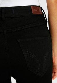 Hollister Co. - HIGH RISE SUPER - Jeans Skinny Fit - black clean - 3