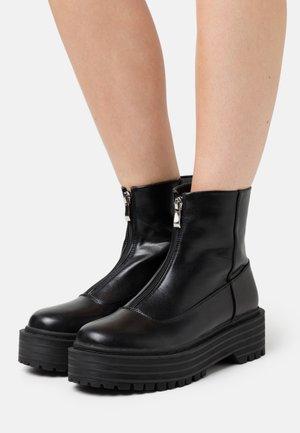 MIRANDA - Platform ankle boots - black