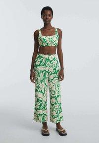OYSHO - TROPICAL - Trousers - green - 1