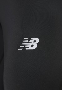 New Balance - ACCELERATE - Leggings - black - 6