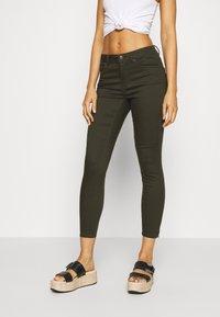Vero Moda - VMTANYA PIPING ZIP - Jeans Skinny Fit - peat - 0