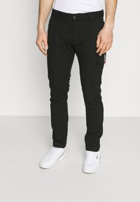 Tommy Jeans - SCANTON DOBBY PANT - Cargo trousers - black - 0