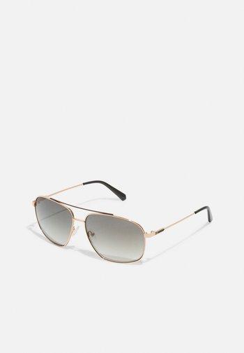 UNISEX - Sluneční brýle - gold-coloured/grün