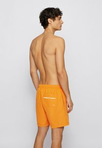 BOSS - DOLPHIN - Swimming shorts - orange - 1