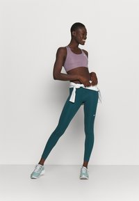 Nike Performance - Leggings - petrol blue - 1
