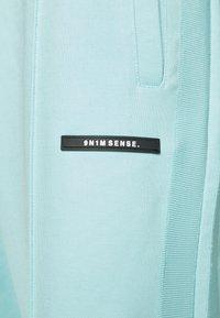9N1M SENSE - STRIPE TRACK PANT UNISEX - Pantalon de survêtement - skyblue - 7