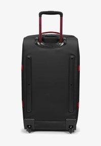 Eastpak - TRANVERZ M - Wheeled suitcase - blakoutstripred - 3