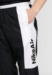 Nike Sportswear - AIR - Verryttelyhousut - black/white - 3