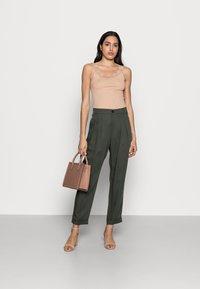 InWear - IZLA PANTS - Trousers - green olive - 1