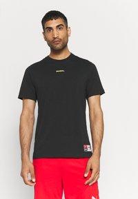 Nike Performance - FC TEE JOGA - T-shirt con stampa - black - 0