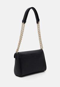 Calvin Klein - FLAP CROSSBODY - Across body bag - black - 1