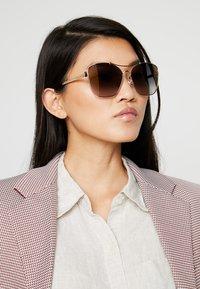 Jimmy Choo - KIMI - Sunglasses - gold-coloured/black - 1