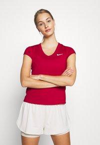 Nike Performance - DRY - Basic T-shirt - gym red/white - 0