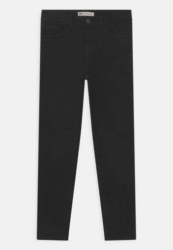 710 SUPER SKINNY  - Skinny džíny - black