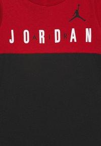 Jordan - BIG BLOCK ROMPER UNISEX - Caraco - black - 2