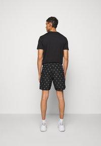 Neil Barrett - ALL OVER SMALL THUNDERBOLT - Shorts - black/white - 2