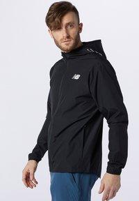 New Balance - Training jacket - black - 2