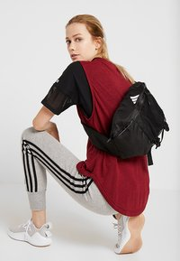 adidas Performance - PARKHOOD  - Across body bag - black/black/white - 5