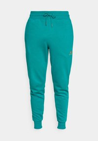 ESSENTIALS EMBRIODERED PANT - Tracksuit bottoms - team teal