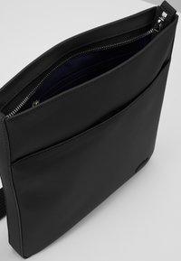 Lacoste - FLAT CROSSOVER BAG - Across body bag - black - 4