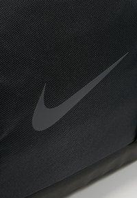 Nike Performance - POWER DUFF - Sports bag - black/black/black - 6