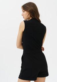 Trueprodigy - MIT KLASSISCHER KNOPFLEISTE - Jumpsuit - black - 1