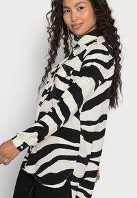 VILA PETITE - VIOMINA - Button-down blouse - black - 3