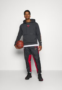 Nike Performance - NBA CHICAGO BULLS CITY EDITION HOODIE - Club wear - anthracite - 1