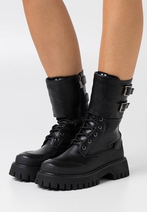 VEGAN NIGHTWOLF - Platform boots - black