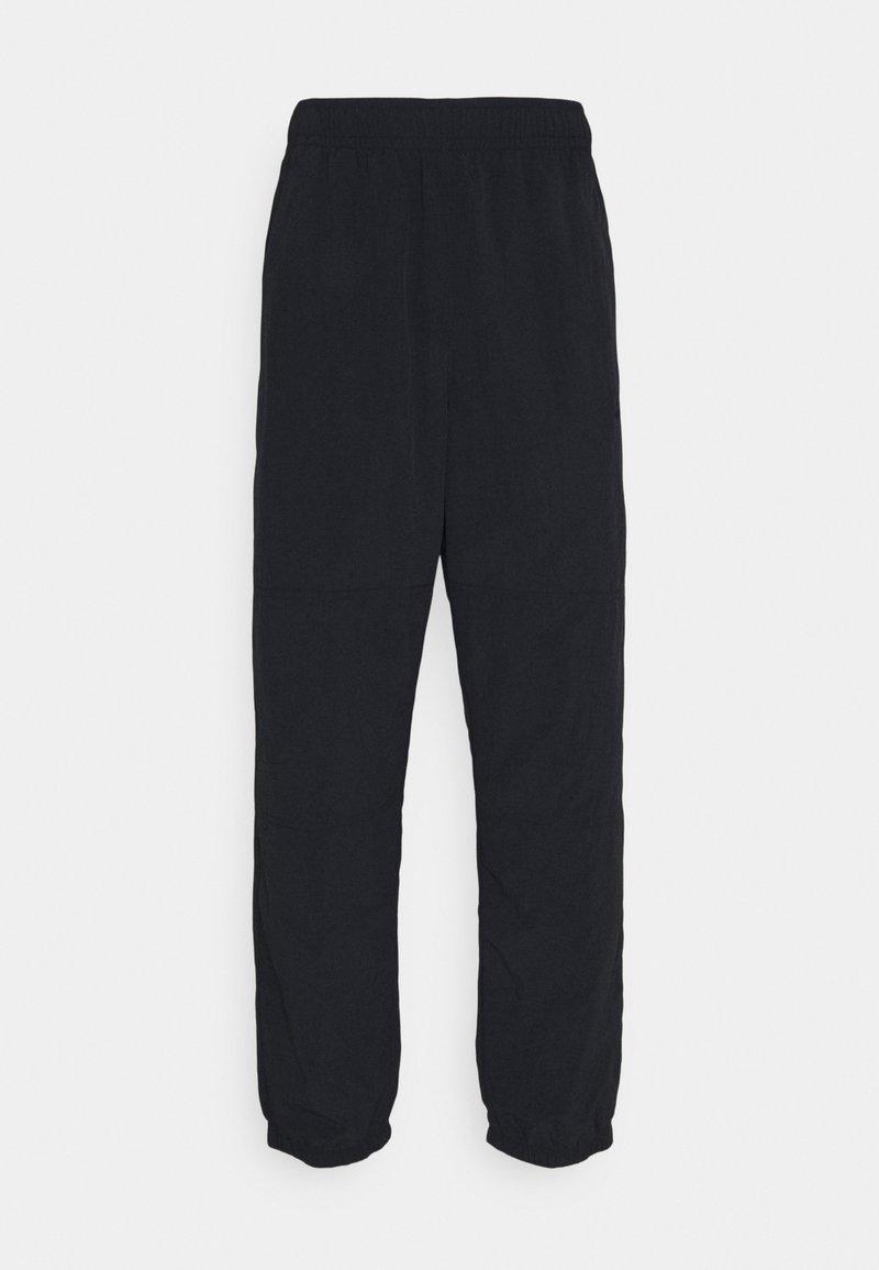 Nike SB - NOVELTY TRACK PANT UNISEX - Tracksuit bottoms - black
