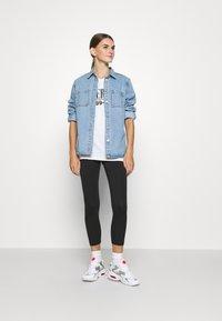 Nike Sportswear - FEMME - Leggings - Trousers - black - 1