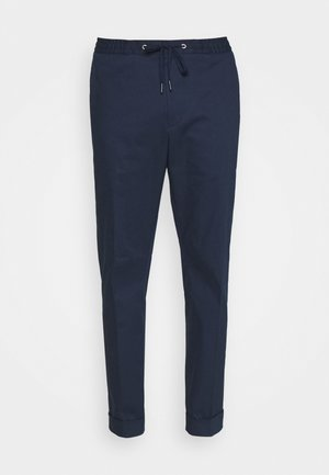 TRAVIN - Trousers - light ink