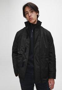 Calvin Klein Jeans - Light jacket - ck black - 0
