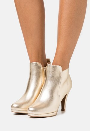 High heeled ankle boots - metal