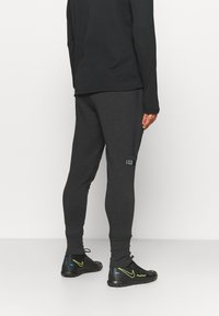 Under Armour - ACCELERATE OFF-PITCH JOGGER - Tracksuit bottoms - black/white - 2