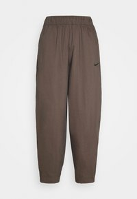 Nike Sportswear - Tracksuit bottoms - ironstone/black - 7