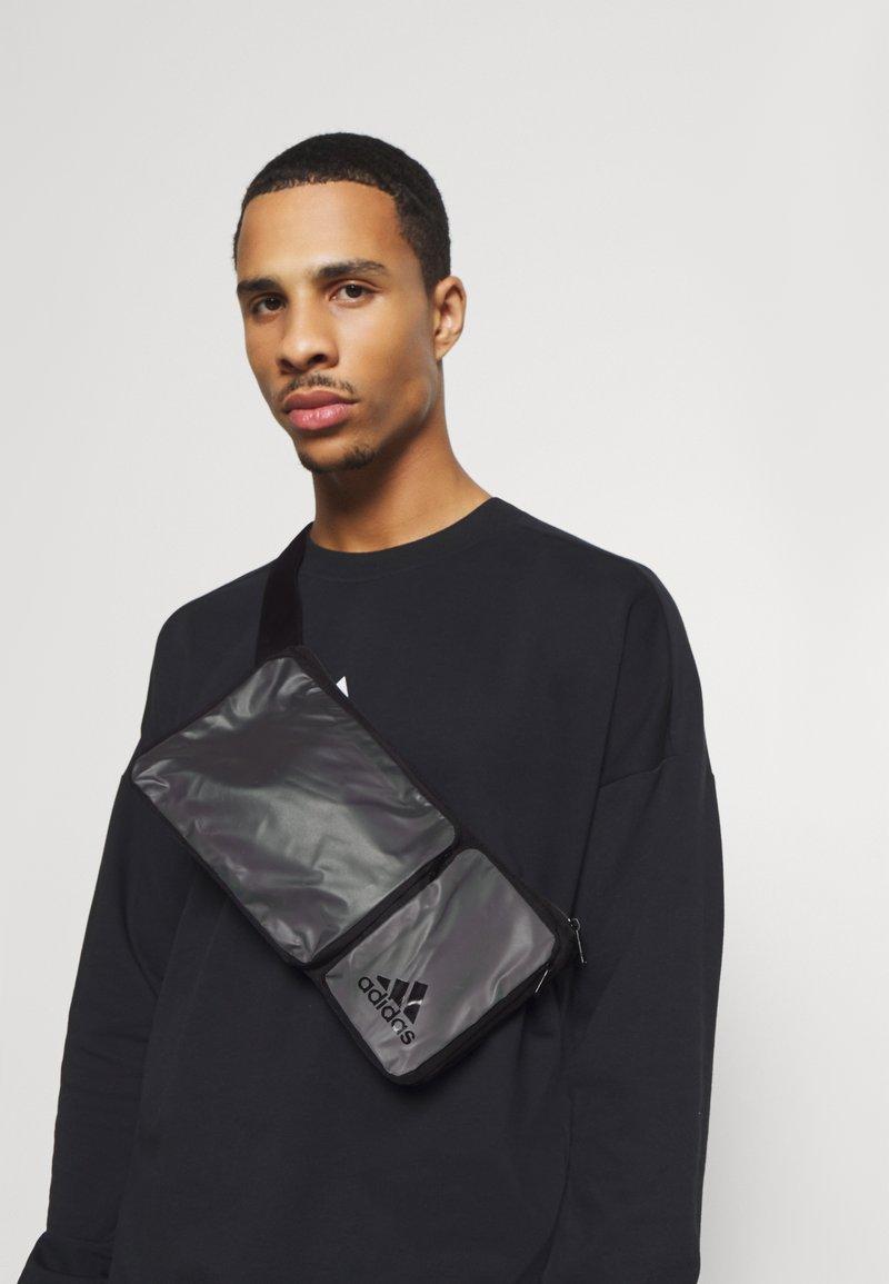 adidas Performance - SLIM TRAINING SPORTS WAISTBAG UNISEX - Across body bag - black