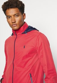 Polo Ralph Lauren Golf - HOOD ANORAK JACKET - Waterproof jacket - sunrise red - 5