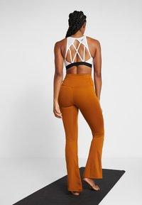 Nike Performance - STUDIO FLARE - Pantalon de survêtement - burnt sienna/black - 2