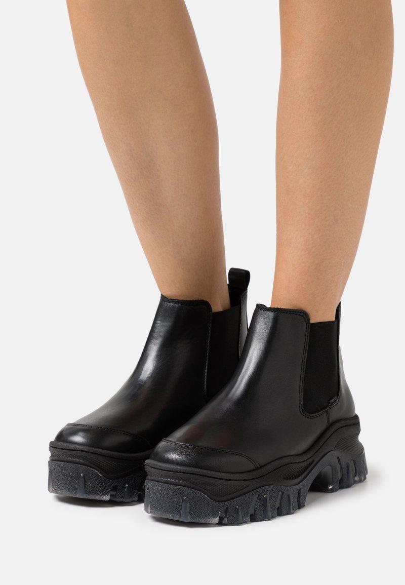 Bronx - JAXSTAR - Platform ankle boots - black