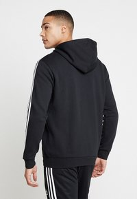adidas Originals - STRIPES UNISEX - Huvtröja med dragkedja - black - 2