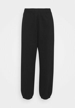 CORINNA  - Tracksuit bottoms - black