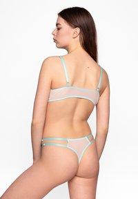 Aurore - String - mintgrün - 1