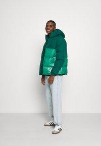 adidas Originals - REGEN PUFF - Down jacket - cgreen - 1