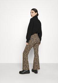 Vila - VIWINNER FLARED PANT - Leggings - brown/black - 2