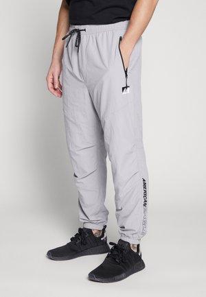 CORE JOGGER - Tracksuit bottoms - grey