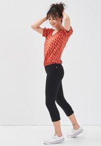 Cache Cache - SCHLANKE EINFARBIGE BASIC-HOSE - Trousers - black - 1