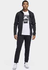 adidas Performance - CROSS-UP 365 TRACKSUIT BOTTOMS - Tracksuit bottoms - black - 1
