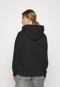 Levi's® - GRAPHIC STANDARD HOODIE - Sweat à capuche - black - 2