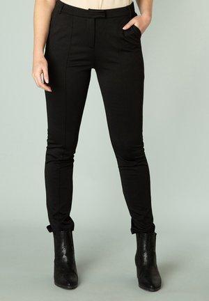 NELISE - Trousers - black